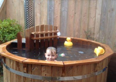 Child and toys in the hot tub
